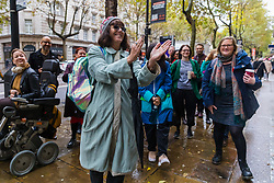 © Licensed to London News Pictures. 01/11/2019. London, UK. Supporters of Television presenter, Samira Ahmed cheer after she arrives at the Central London Employment Tribunal to attend an equal pay case hearing against the BBC. Samira Ahmed, who presents Newswatch on BBC One and Radio 4's Front Row claims she was paid less than male colleagues for doing equivalent work under the Equal Pay Act. Photo credit: Vickie Flores/LNP