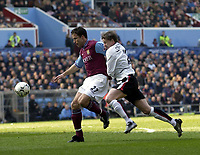 Copyright Sportsbeat. 0208 3926656<br />Picture: Henry Browne<br />Date: 15/03/2003<br />Aston Villa v Manchester United FA Barclaycard Premiership<br />Ole Gunnar Solskjaer of United tries to get to grips with Ronny Johnsen of Villa