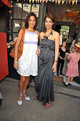 Left to right, ASTRID MUNOZ and party host Eva Karayiannis at the 10th anniversary party of the store Caramel, Ledbury Road, London W11.  The party was held in association with the Naked Heart Foundation - a charity set up by model Natalia Vodianova.