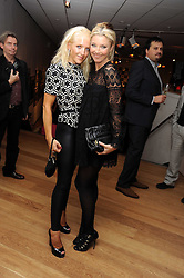 Left to right, sisters CLARE VAN DAM and TAMARA BECKWITH at the TAG Heuer British Formula 1 Party at the Mall Galleries, London on 15th September 2008.