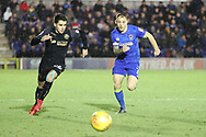 AFC Wimbledon defender Barry Fuller (2) and Wigan Athletic defender Reece James (26) battles for possession during the EFL Sky Bet League 1 match between AFC Wimbledon and Wigan Athletic at the Cherry Red Records Stadium, Kingston, England on 16 December 2017. Photo by Matthew Redman.