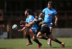 Dries Swanepoel of the Blue Bulls gets his pass away as Gerrit van Wyk of Boland makes the tackle during the Currie Cup premier division match between the Boland Cavaliers and The Blue Bulls held at Boland Stadium, Wellington, South Africa on the 23rd September 2016<br /> <br /> Photo by:   Shaun Roy/ Real Time Images