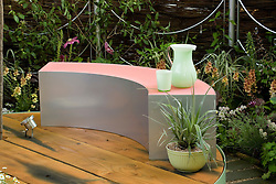 Silver and pink perspex bench on circular deck. The Crystal Cobweb Garden. Designer:  Freya Lawson - Chelsea 2005
