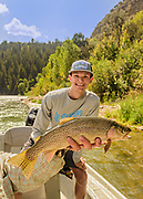 LB catches a 19.5 inch Rainbow Trout on a dry fly while flyfishing on the Upper Narrows of the Teton River near Drggs, Idaho. The fish was released unharmed after the photograph.