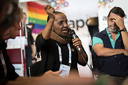 """26 July 2018, Amsterdam, the Netherlands: Nozibele Pearl Moroasui from South Africa participates in morning prayers in the Interfaith Networking Zone, on the theme of """"Faith against Gender based violence - Thursdays in Black"""". On 23-27 July 2018 in Amsterdam, the Netherlands, the World Council of Churches - Ecumenical Advocacy Alliance in collaboration with faith and other partners hosts an Interfaith Networking Zone in the International AIDS Conference's Global Village area, providing a dynamic space for exchanges, resources and workshops. The Global Village is an integral part and recurring feature of the International AIDS Conference, and offers an accessible venue intended to strengthen the connection between the international conference and the local hosting community."""