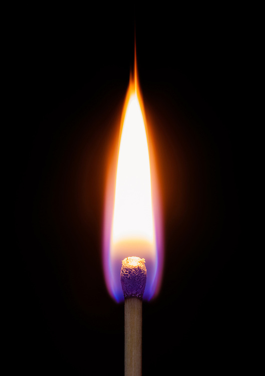 Close up of a match on fire.