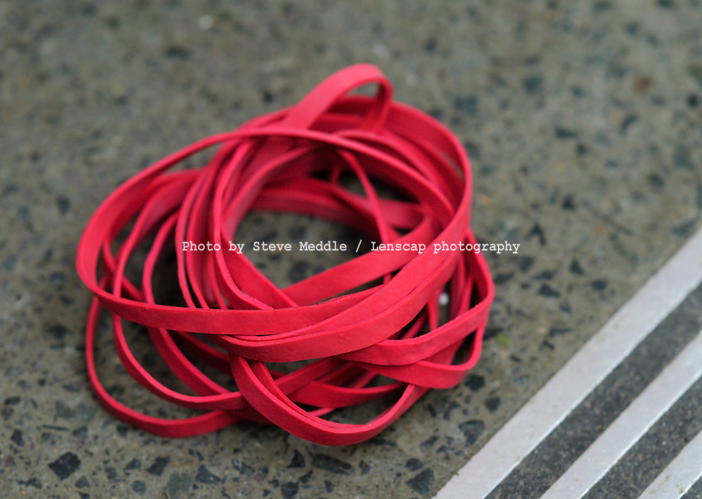 Discarded Red Post Office Elastic Bands
