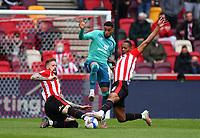 Football - 2020 / 2021 Sky Bet Championship - Semi-final play-offs - Second leg - Brentford vs AFC Bournemouth - Brentford Community Stadium<br /> <br /> Arnaut Danjuma of Bournemouth battles for possession with Pontus Jansson (l) and Ethan Pinnock of Brentford.<br /> <br /> COLORSPORT/ASHLEY WESTERN