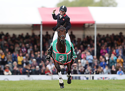 Piggy French celebrates her victory on Vanir Kamira during day four of the 2019 Mitsubishi Motors Badminton Horse Trials at The Badminton Estate, Gloucestershire.