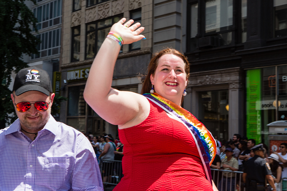 New York, NY - 25 June 2017. New York City Heritage of Pride March filled Fifth Avenue for hours with groups from the LGBT community and it's supporters. NY transgender firefighter Brooke Guinan, a Grand Marshall, riding in the march.