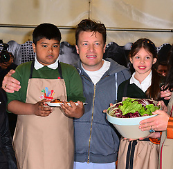Shahanur Rahman (10) from Rotherfield Primary School, Jamie Oliver, Ellie May Farrelly (10) from Rotherfield Primary School,  during Jamie Oliver 's street party Food Revolution Day.  Kirstie Allsopp, Victoria Pendleton, join Oliver as he hosts street party outside his Shoreditch restaurant Fifteen, to celebrate Food Revolution Day, London, United Kingdom, May 17, 2013. Photo by: Nils Jorgensen / i-Images