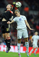 Jo Potter of England Women is challenged by Alexandra Popp of Germany Women<br /> - Womens International Football - England vs Germany - Wembley Stadium - London, England - 23rdNovember 2014  - Picture Robin Parker/Sportimage