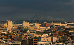 30 August, 2005. New Orleans Louisiana.  Hurricane Katrina aftermath. <br /> Looking west over the city from the Hyatt Hotel as Katrina slips away and the sun comes out over the Crescent City connection bridge.<br /> Photo Credit: Charlie Varley/varleypix.com