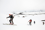 Glaciologists take a break from work to go backcountry skiing on Thompson Pass, in the Chugach Mountains near Valdez, Alaska.