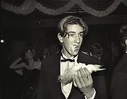Toby Russell eating candy floss, Feather Ball. Hammersmith Palais, 19 December 1988.
