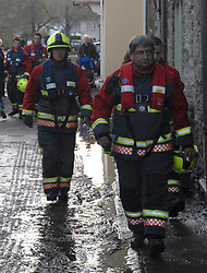 ©London News pictures... 17/11/2010. Search and rescue teams . The River Fowey burst its banks at Lost Withiel in Cornwall. today (Wednesday). Some people have been left trapped in their cars and homes in parts of Cornwall as heavy rain and gale-force winds caused flooding and disruption.