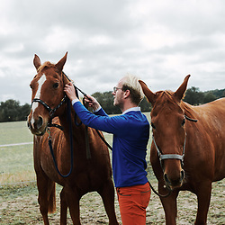 Xavier Desforges, from Maison Caulieres, catering to his horse. Dolus-le-Sec, France. October 7, 2019.