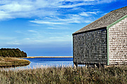 Nauset Marsh salt pond and rustic shack boat shack leading out to Cape Cod National Seashore, Eastham, Cape Cod, MA