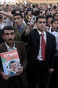 Baku, Azerbaijan, 11/10/2003..Opposition demonstration in support of the candidacy of National Independence Party leader Etibar Mammadov in forthcoming Presidential elections. A man uses his mobile phone to relay speakers at the meeting..........