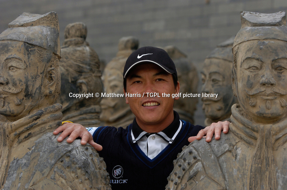 China's number one golfer Lian-wei ZHANG (PRC) pictured with Emperor Ying Zheng famous Terra Cotta Army clay soldiers nearby the Great Wall of China  during the week of Johnnie Walker Asian Classic 2005,Pine Valley Resort & Country Club,Beijing,China