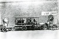 1930 Otto K. Olesen standing by one of his illuminating trucks
