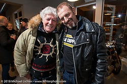 Biker Billy of Italian Choppers with a friend at the Mr. Martini Friday night party celebrating the opening of his bar / restaurant at the workshop during the Motor Bike Expo. Verona, Italy. January 22, 2016.  Photography ©2016 Michael Lichter.