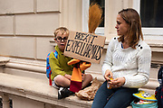 A boy holds a sign with the text Brexit Expelliarmus, referring to a spell used in the Harry Potter book meaning disarm your opponent.
