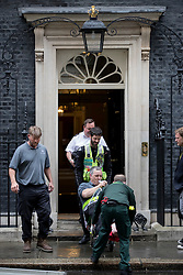 © Licensed to London News Pictures. 15/05/2017. London, UK. An worker is taken from 10 Downing Street after he was injured inside. A COBRA meeting is being held later as members of British government are meeting to discuss the recent cyber attack on over 150 countries, which crippled parts of the NHS.  Photo credit: Peter Macdiarmid/LNP