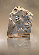Ancient Egyptian relief portrait of King Akhenaten from Amarna. 18th Dynasty 1340 BC . Neues Museum Berlin Cat No: AM 14512. .<br /> <br /> If you prefer to buy from our ALAMY PHOTO LIBRARY  Collection visit : https://www.alamy.com/portfolio/paul-williams-funkystock/ancient-egyptian-art-artefacts.html  . Type -   Neues    - into the LOWER SEARCH WITHIN GALLERY box. Refine search by adding background colour, subject etc<br /> <br /> Visit our ANCIENT WORLD PHOTO COLLECTIONS for more photos to download or buy as wall art prints https://funkystock.photoshelter.com/gallery-collection/Ancient-World-Art-Antiquities-Historic-Sites-Pictures-Images-of/C00006u26yqSkDOM