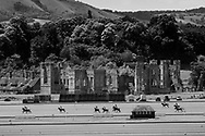 Polo ponies and players in action during the King Power Gold Cup; 2020. Cowdray Park Polo Club. Midhurst, West Sussex. <br /> Picture date: Sunday July 5, 2020.<br /> Photograph by Christopher Ison ©<br /> 07544044177<br /> chris@christopherison.com<br /> www.christopherison.com<br /> <br /> IMPORTANT NOTE REGARDING IMAGE LICENCING FOR THIS PHOTOGRAPH: This image is sold as an open edition print by the artist. No secondary sales or reproduction permitted unless expressly agreed in writing by the photographer.