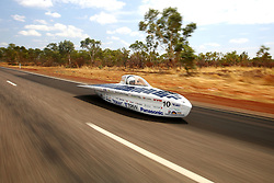 October 09 - Tennant Creek, Australia - University Tokai Challenger vehicle ''Tokai'' from Japan races between Renner Springs and Tennants Creek in the Challenger Class on Day 2 of the 2017 Bridgestone World Solar Challenge in Elliott, Australia. Teams from across the globe are competing in the 2017 World Solar Challenge, a 3000 km solar-powered vehicle race between Darwin and Adelaide. The race begins on October 8th with the first car expected to cross the finish line on October 11th. (Credit Image: © Xu Haijing/Xinhua via ZUMA Wire)