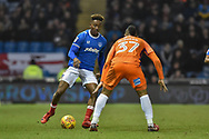 Portsmouth Forward, Jamal Lowe (18) takes on Northampton Town Midfielder, Lewis McGugan (37) during the EFL Sky Bet League 1 match between Portsmouth and Northampton Town at Fratton Park, Portsmouth, England on 30 December 2017. Photo by Adam Rivers.