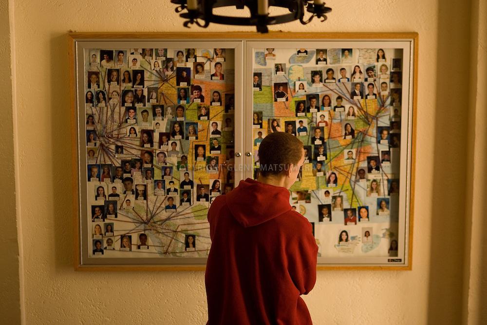Stanford freshman orientation. Chris Whiteman of Leesburg, VA looks over map of new freshman in Branner Hall. He's wearing a Stanford sweatshirt.