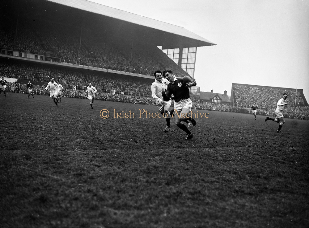 Irish Rugby Football Union, Ireland v England, Five Nations, Landsdowne Road, Dublin, Ireland, Saturday 14th February, 1959,.14.2.1959, 2.14.1959,..Referee- D Gwynne Walters, Welsh Rugby Union, ..Score- Ireland 0 - 3 England, ..Irish Team, ..N J Henderson, Wearing number 15 Irish jersey, Full back, N.I.F.C, Rugby Football Club, Belfast, Northern Ireland,..N H Brophy, Wearing number 14 Irish jersey, Right wing, University College Dublin Rugby Football Club, Dublin, Ireland, ..A J O'Reilly, Wearing number 13 Irish jersey, Right Centre, Old Belvedere Rugby Football Club, Dublin, Ireland, and, Leicester Rugby Football Club, Leicester, England, ..J F Dooley, Wearing  Number 12 Irish jersey, Left Centre, Galwegians Rugby Football Club, Galway, Ireland, ..A C Pedlow, Wearing number 11 Irish jersey, Left wing,  C I Y M S Rugby Football Club, Belfast, Northern Ireland, ..M A English, Wearing number 10 Irish jersey, Outside Half, Bohemians Rugby Football Club, Limerick, Ireland,..A A Mulligan, Wearing number 9 Irish jersey, Scrum Half, London Irish Rugby Football Club, Surrey, England, ..B G Wood, Wearing number 1 Irish jersey, Forward, Garryowen Rugby Football Club, Limerick, Ireland, ..A R Dawson, Wearing number 2 Irish jersey, Captain of the Irish team, Forward, Wanderers Rugby Football Club, Dublin, Ireland, ..S Millar, Wearing number 3 Irish jersey, Forward, Ballymena Rugby Football Club, Antrim, Northern Ireland,..W A Mulcahy, Wearing number 4 Irish jersey, Forward, University College Dublin Rugby Football Club, Dublin, Ireland, ..M G Culliton, Wearing number 5 Irish jersey, Forward, Wanderers Rugby Football Club, Dublin, Ireland, ..N A Murphy, Wearing number 6 Irish jersey, Forward, Cork Constitution Rugby Football Club, Cork, Ireland,..P J A O' Sullivan, Wearing  Number 7 Irish jersey, Forward, Galwegians Rugby Football Club, Galway, Ireland,..J R Kavanagh, Wearing number 8 Irish jersey, Forward, Wanderers Rugby Football Club, Dublin, Ireland, ..English Team, ..J G G