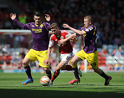 Bristol City's Scott Wagstaff jostles for the ball with Notts County's Josh Vela and Notts County's James Spencer - Photo mandatory by-line: Dougie Allward/JMP - Mobile: 07966 386802 18/04/2014 - SPORT - FOOTBALL - Bristol - Ashton Gate - Bristol City v Notts County - Sky Bet League One