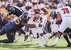 Nov 9, 2019; Morgantown, WV, USA; Texas Tech Red Raiders running back Ta'Zhawn Henry (26) shakes a tackle from West Virginia Mountaineers defensive lineman Dante Stills (55) and runs for extra yards during the third quarter at Mountaineer Field at Milan Puskar Stadium. Mandatory Credit: Ben Queen-USA TODAY Sports