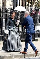 """Moray Place in Edinburgh's Georgian old town was turned into 19th century London for Julian Fellowes' new ITV show """"Belgravia"""".<br /> <br /> Pictured: Tamsin Greig (striped dress) between takes<br /> <br /> Alex Todd 