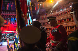 © London News Pictures. Pictured: The Garrison Sergeant Major WO1 Vern Stokes, checks the Standard Bearers before they march into the centre of The Royal Albert Hall, London during the Festival of Remembrance on Saturday 7th November 2015.. Photo credit: Rupert Frere/LNP