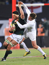 Coca Cola Park, Johannesburg. Springboks vs England 2nd Test. 160612. England's Toby Flood tackles Springfbok eighthman Pierre Spies. Picture: Etienne Rothbart.