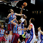 Anadolu Efes's Stephane Lasme (C) and Trabzonspor's Andrija Stipanovic (R) during their Turkish Basketball League Play Off Semi Final round 2 match Anadolu Efes between Trabzonspor at Abdi Ipekci Arena in Istanbul Turkey on Friday 31 May 2015. Photo by Aykut AKICI/TURKPIX