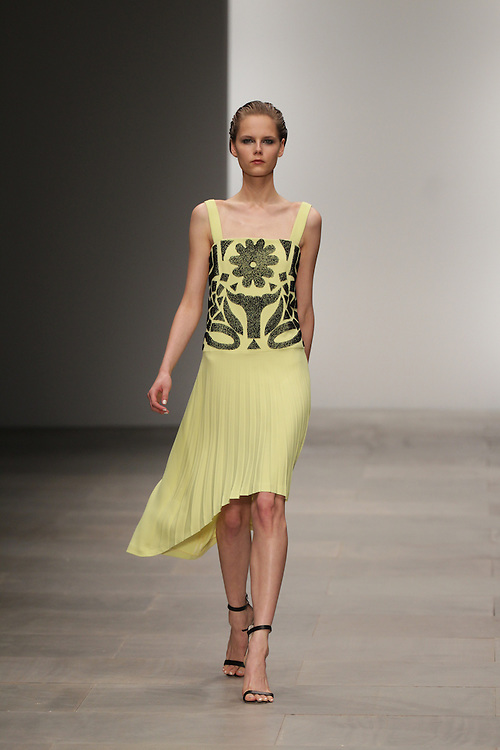 Models walk the runway for the SS 2012 Osman fashion show held during London Fashion Week in London, UK.