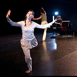 © Licensed to London News Pictures. 17.02.2012. London, UK. A new work by choreographer/director Jacky Lansley, Guest Suites is inspired by Bach's Cello Suites, six dance suites for unaccompanied cello. Featuring composer Jonathan Eato, dancers Fergus Early, Esther Huss, Hannah Mi, Huri Murphy, David Ogle, Sanna E. Ryg and Tim Taylor, whilst Audrey Riley plays live cello. At the Clore Studio, Royal Opera House, London 2012. Photo credit : Tony Nandi/LNP