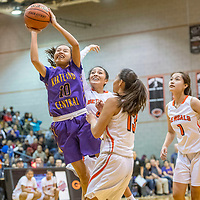 Kirtland Central Bronco Haile Gleason (10), left, elevates for a jump-shot a above Gallup Bengals Journey Gillson (4), center, Hanna Toledo (13) and Ashley Antone (1) in the District 1-5A girls tournament at Gallup High School Thursday.