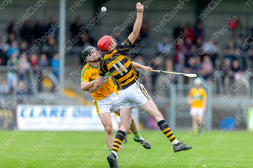 Tubber's Domhnall McMahon and Feakle's Eoin Touhy challenge for the high ball