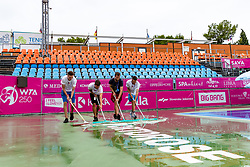 PORTOROZ, SLOVENIA - SEPTEMBER 16: Workers drying the court after the rain at WTA 250 Zavarovalnica Sava Portoroz at SRC Marina, on September 15, 2021 in Portoroz / Portorose, Slovenia. Photo by Matic Klansek Velej / Sportida
