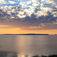 """""""Dawn above Mackinac""""<br /> <br /> Amazing clouds form over Mackinac Island just after sunrise on Lake Huron, as viewed from St. Ignace Michigan!<br /> <br /> Sunrise Images by Rachel Cohen"""