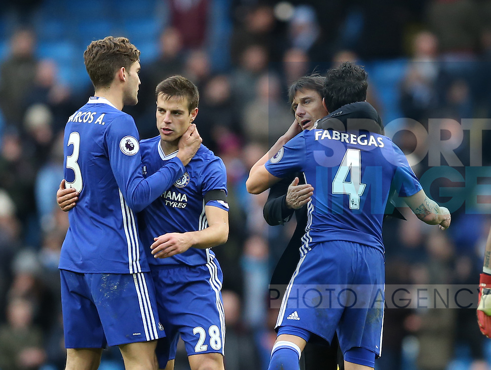 Antonio Conte manager of Chelsea hugs Cesc Fabregas of Chelsea during the Premier League match at the Etihad Stadium, Manchester. Picture date: December 3rd, 2016. Pic Simon Bellis/Sportimage