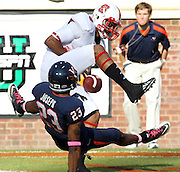 Oct. 22, 2011 - Charlottesville, Virginia - USA; Virginia Cavaliers cornerback Dom Joseph (23) breaks up a pass to North Carolina State wide receiver Quintin Payton (88) during an NCAA football game at the Scott Stadium. NC State defeated Virginia 28-14. (Credit Image: © Andrew Shurtleff