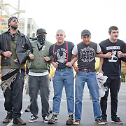 A group of skinheads block the path of the regional chapter of the Klu Klux Klan and National Socialist Movement as they marched back to their cars after holding a rally near uptown charlotte.