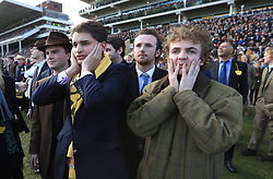 Racegoers watch the action during St Patrick's Thursday of the 2018 Cheltenham Festival at Cheltenham Racecourse.